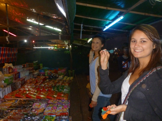 Bec and Rachel playing darts at the fair ground